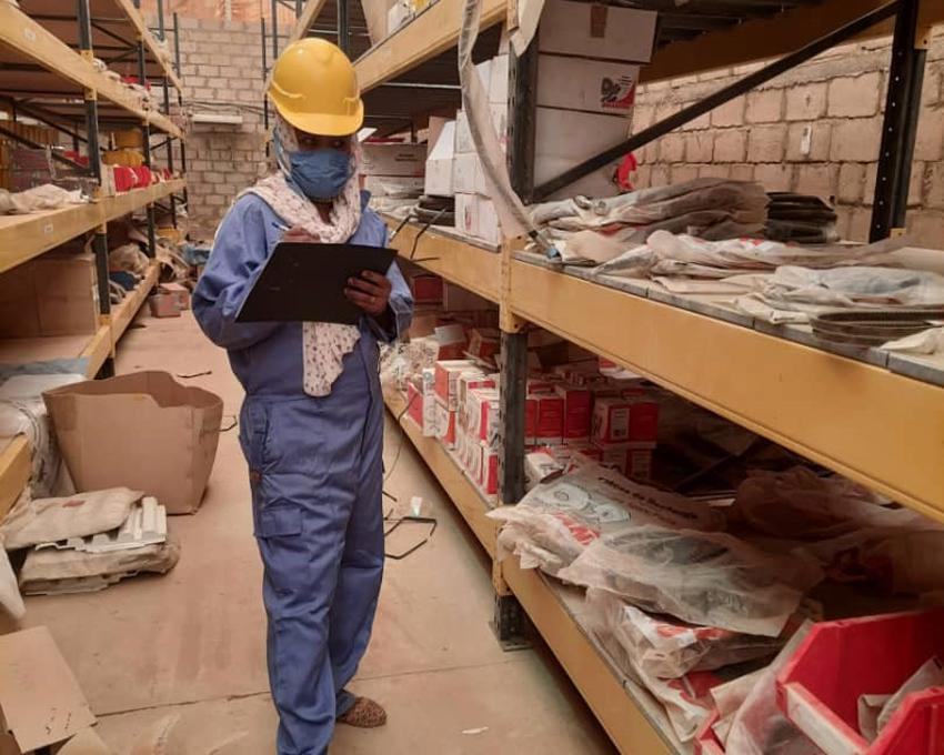Ekram Fator, UN Volunteer Warehouse Assistant, checking fast moving spare parts in El-Fasher, Sudan.