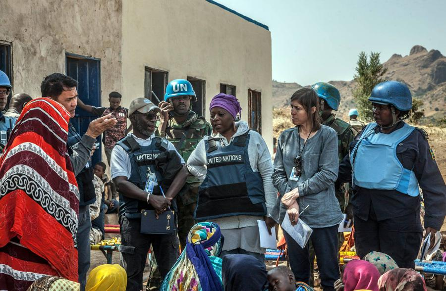 UN Volunteer William Joof (second from the left), facilitating a UN Sanctions Committee's security assessment visit to Dorsa, controlled by the Sudan Liberation Movement/Army (SLA), in Central Darfur.