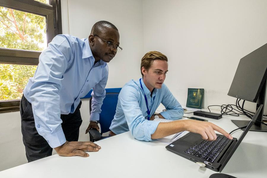 UN Volunteers Godfrey Mukalazi (left) and Kyle Jacque (right) consulting on activities for the project to Support the Sudanese Peace Process