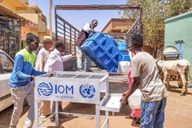 Distribution of IOM hand-washing facilities to a community centre for children and youth living on the streets in Ombeda locality, Omdurman-Khartoum State, during COVID-19 Awareness Raising Campaign.